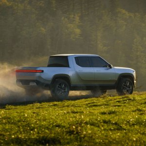 2020 Rivian R1T Driving on Grass Hill