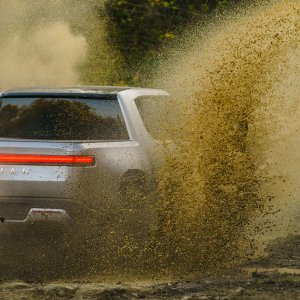 2020 RIvian R1T Driving through mud area