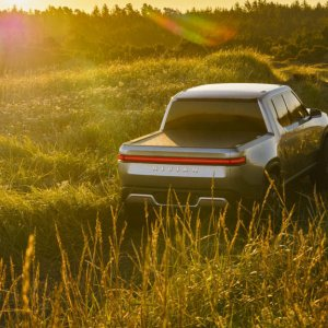 2020 Rivian R1T Driving In Grass Area