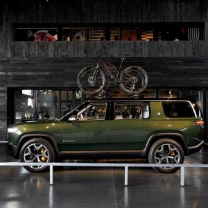 2020 Rivian R1S side shot with roof rack and bicycle on top