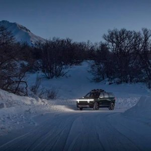 2020 Rivian R1S driving through snow path