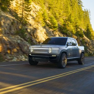 2020 Rivian R1T Driving On Rural Road Tree Side